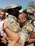Freed Palestinian prisoner Mahmoud Abu Amra is welcomed by a member of al-Aqsa brigades, the armed wing of Fatah movement, upon his release from an Israeli jail, in Deir al-Balah in the central Gaza Strip, July 30, 2015. Abu Amra served 12 years in the Israeli jail after he was convicted of being a member of Fatah armed wing and for taking part in clashes against the Israeli army, according to his family. Photo by Ashraf Amra