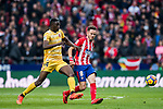 Saul Niguez Esclapez (R) of Atletico de Madrid vies for the ball with Michael Olunga Ogada of Girona FC during the La Liga 2017-18 match between Atletico de Madrid and Girona FC at Wanda Metropolitano on 20 January 2018 in Madrid, Spain. Photo by Diego Gonzalez / Power Sport Images