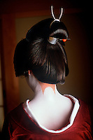 Kyoto, Japan. Sanbon Ashi decoration on a geisha's sensual neck. In traditional Japanese aesthetics the most alluring part of a woman is the nape of her neck. Sanbon Ashi is special design of unpainted skin on the back of the neck.