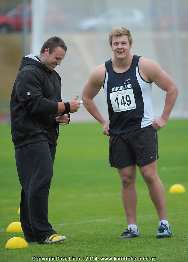 Shot putters Tom Walsh and Jacko Gill chat during day two of the 2014 National Track and Field Championships at Newtown Park, Wellington, New Zealand on Saturday, 29 March 2014. Photo: Dave Lintott / lintottphoto.co.nz