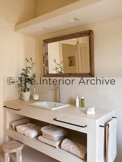 The built-in wash stand has generous storage space for towels and blends seamlessly with the rest of the bathroom