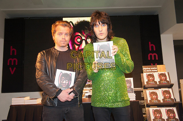 guest & Noel Fielding (The Mighty Boosh).signs copies of his new art book,  'The Scribblings Of A Madcap Shambleton', HMV, Oxford Street , London, England. 9th October 2011.half length top black leather jacket green beads beaded  .CAP/HT.©Hugh Thompson/Capital Pictures.