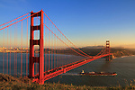 As the sun sets, the Golden Gate Bridge takes on a beautiful warm glow.<br /> Available sizes:<br /> <br /> 12&quot; x 18&quot; print <br /> 12&quot; x 18&quot; gallery wrap<br /> See Pricing page for more information. Also available as a mousepad or greeting cards.