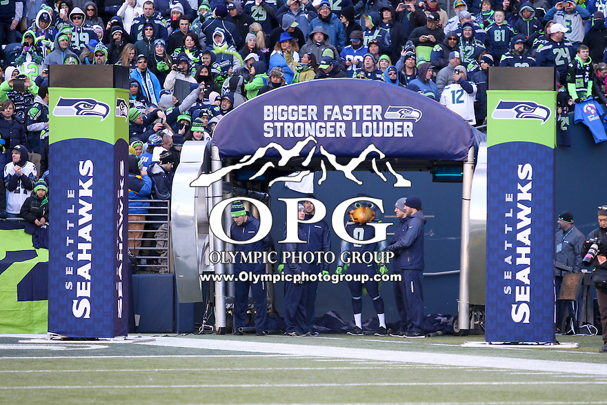 2014-02-05:  Seattle Seahawks mascot Blitz lead the players out on the field. Seattle Seahawks players and 12th man fans celebrated bringing the Lombardi trophy home to Seattle during the Super Bowl Parade at Century Link Field in Seattle, WA.