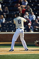Jake Mueller (6) of the Wake Forest Demon Deacons at bat against the Gardner-Webb Runnin' Bulldogs at David F. Couch Ballpark on February 18, 2018 in  Winston-Salem, North Carolina. The Demon Deacons defeated the Runnin' Bulldogs 8-4 in game one of a double-header.  (Brian Westerholt/Four Seam Images)