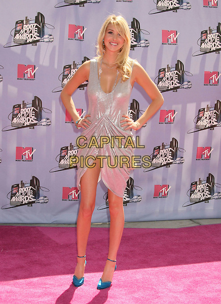WHITNEY PORT.2007 MTV Movie Awards held at the Gibson Amphitheater, Universal City, California, USA..June 3rd, 2007.full length silver dress gathered hands on hip blue shoes shiny .CAP/ADM/RE.©Russ Elliot/AdMedia/Capital Pictures *** Local Caption *** ...