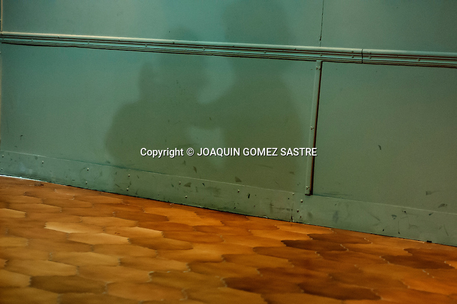 Shadow of a couple dancing a tango on a wall of the premises of the association<br />  PHOTO &copy; JOAQUIN GOMEZ  SASTRE