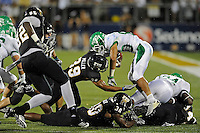 1 September 2011:  FIU tight end Jonathan Faucher (30) and defensive back Sam Miller (39) combine to stop North Texas wide receiver Brelan Chancellor (80) during a kickoff return as the FIU Golden Panthers defeated the University of North Texas, 41-16, at FIU Stadium in Miami, Florida.