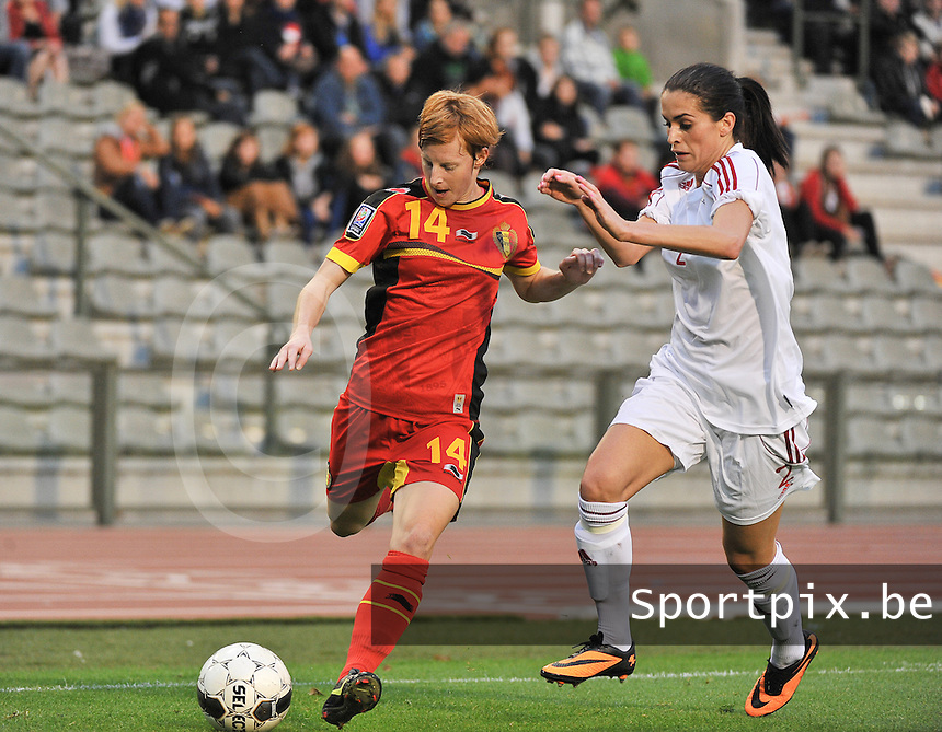 20130921 - BRUSSELS , BELGIUM : Belgian Lien Mermans (14) pictured with Albanian Robeli Arbnora (2)  during the female soccer match between Belgium and Albania , on the first matchday in group 5 of the UEFA qualifying round to the FIFA Women World Cup in Canada 2015 at the Koning Boudewijn Stadion , Brussels . Saturday 21th September 2013. PHOTO DAVID CATRY