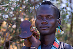Bena Man holding headrest, Bena Tribe, Omo Valley, Ethiopia, portrait, person, one, tribes, tribal, indigenous, peoples, Southern, ethnic, rural, local, traditional, culture, primitive, cattle herder.Africa....