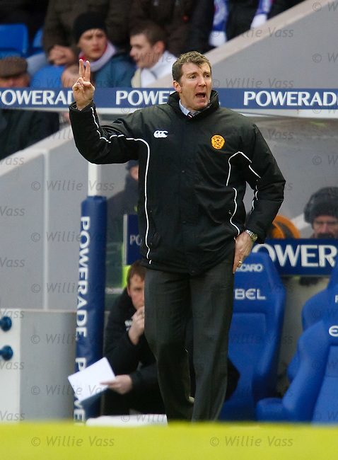 Motherwell manager Jim Gannon gestures from the sidelines