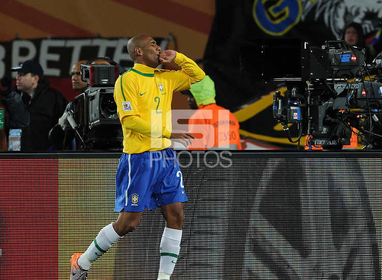 Brazil defender Maicon celebrates his goal, which gave his team a 1-0 lead in the 55th minute against North Korea. Brazil defeated North Korea, 2-1, in both teams' opening match of play in Group G of the 2010 FIFA World Cup. The match was played at Ellis Park in Johannesburg, South Africa June 15th.