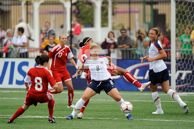 Amy Rodriguez (8) of the United States (USA) holds off Candace Chapman (9) of Canada (CAN). The United States (USA) Women's National Team defeated Canada (CAN) 1-0 during an international friendly at Marina Auto Stadium in Rochester, NY, on July 19, 2009.
