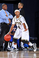 12 November 2010:  FIU's Phil Gary, Jr. (4) handles the ball in the first half as the FIU Golden Panthers defeated the Florida Memorial Lions, 89-73, at the U.S. Century Bank Arena in Miami, Florida.