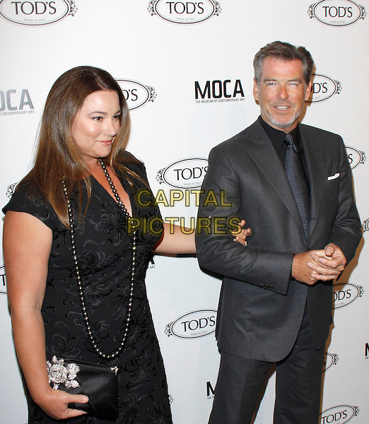 KEELY SHAYE SMITH & PIERCE BROSNAN.The Diego Della Valle Cocktail Celebration Honoring Tod's Beverly Hills Boutique And MOCA's New Director Jerry Deitch at Tod's Boutique in Beverly Hills, California, USA..half length sleeveless dress clutch bag  wife husband married beard facial hair grey gray tie black shirt necklace arms linked .CAP/RKE/DVS.©DVS/RockinExposures/Capital Pictures.