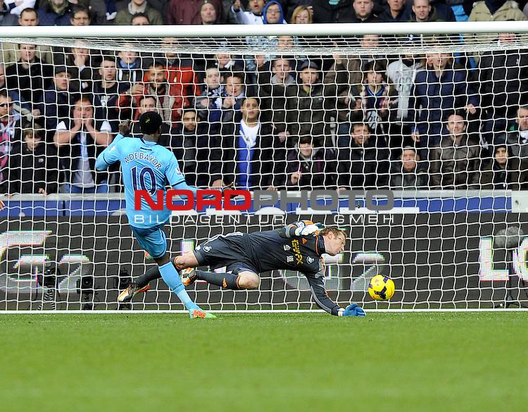 Tottenham Hotspur's Emmanuel Adebayor scores his second and tottenhams third of the game -   19/01/2014 - SPORT - FOOTBALL - Liberty Stadium - Swansea - Swansea City v Tottenham Hotspur - Barclays Premier League<br /> Foto nph / Meredith<br /> <br /> ***** OUT OF UK *****