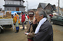 """March 30, 2011, Ishinomaki, Miyagi, Japan - More than two weeks after the tsunami, volunteer groups look to contribute to the relief effort. """"I don't have an address anymore, so I don't know what to give you."""" Mr. Uematsu told Satoko Tamaki, a Peaceboat volunteer who was coordinating relief efforts in the Shirasagidani neighborhood. (Photo by Wesley Cheek/AFLO) [3682]."""