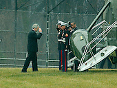 Washington, D.C. - December 22, 2006 -- United States President George W. Bush salutes as he and first lady Laura Bush depart the Walter Reed Army Medical Center in Washington, D.C. aboard Marine 1 following their participation in a holiday service project on Friday, December 22, 2006.  The first family will celebrate Christmas at Camp David before returning to their ranch in Crawford, Texas for the New Year's holiday.<br /> Credit: Ron Sachs - Pool via CNP