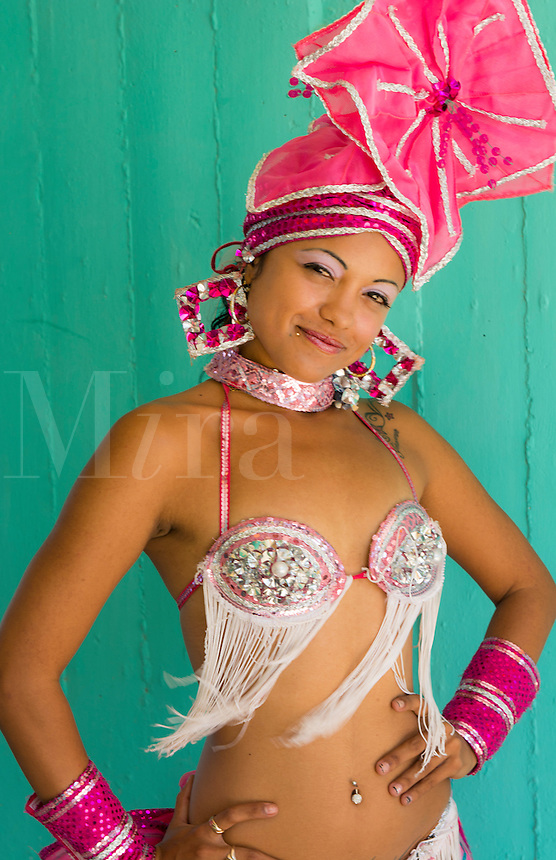 Trinidad Cuba beautiful dancer in costume portrait with headress and color from tourist show   12