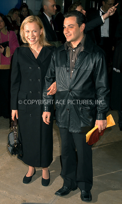 Oksana Baiul and husband at the opening night of 'Fiddler on the Roof' on Broadway. New York, February 26, 2004.  Please byline: AJ SOKALNER/ACE Pictures.   ..*PAY-PER-USE*      ....IMPORTANT: Please note that our old trade name, NEW YORK PHOTO PRESS (NYPP), is replaced by new name, ACE PICTURES. New York Photo Press and ACE Pictures are owned by All Celebrity Entertainment, Inc.......All Celebrity Entertainment, Inc:  ..contact: Alecsey Boldeskul (646) 267-6913 ..Philip Vaughan (646) 769-0430..e-mail: info@nyphotopress.com