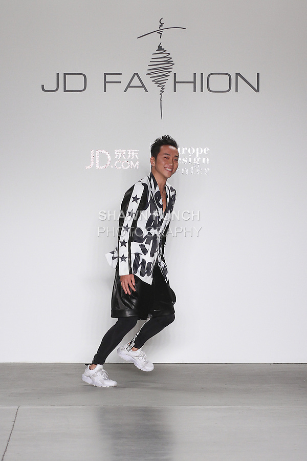 Fashion designer Chi Zhang thanks audience for attending his Chi Zhang Fall 2016 collection, for the JD Fashion Fall 2016 runway show at Pier 59 Studios for NYFW: The Shows, during New York Fashion Week Fall 2016.