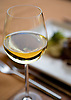 A glass of white wine at the Banyan Tree restaurant at the Ritz-Carlton, Kapalua, on Maui, Hawaii. Photo by Kevin J. Miyazaki/Redux