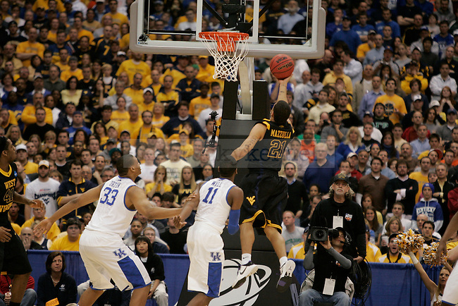 West Virginia's Joe Mazzulla goes for the basket against Kentucky at the Carrier Dome on Saturday, March 27, 2010. Mazzulla finished the game with 17 points to help the mountaineers defeat the cats 73-66 in the Elite 8 round. Photo by Scott Hannigan | Staff