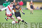 Austin Stacks Eamonn McAllen gets ahead of An Ghaeltacht's Cian Ó Múrchu at Connolly park, Tralee on Saturday.