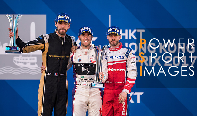 Sam Bird (c) of Great Britain from DS Virgin Racing celebrates with Jean-Eric Vergne (l) of France from TECHEETAH and Nick Heidfeld of Germany from Mahindra Racing  after winning the FIA Formula E Hong Kong E-Prix Round 1 at the Central Harbourfront Circuit on 02 December 2017 in Hong Kong, Hong Kong. Photo by Marcio Rodrigo Machado / Power Sport Images