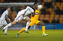 """Don's Joe Shaugnessy heads clear from Motherwell""""s Zaine Francis Angol   ."""
