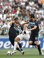 Calcio, Serie A: Juventus - Lazio, Torino, Allianz Stadium, 25 agosto, 2018.<br /> Juventus' Cristiano Ronaldo (c) in action with Lazio's Lucas Leiva (l) and Marco Parolo (r) during the Italian Serie A football match between Juventus and Lazio at Torino's Allianz stadium, August 25, 2018.<br /> UPDATE IMAGES PRESS/Isabella Bonotto