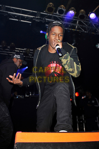 A$AP Rocky (Rakim Mayers) performing live in concert, Electric Ballroom, Camden, London, England. .5th June 2012.on stage in concert live gig performance music half length black jeans denim green camouflage jacket 3/4 singing full red print classics paramount .CAP/MAR.© Martin Harris/Capital Pictures.