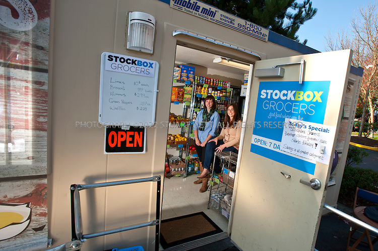 10/27/2011--Seattle, WA, USA...Carrie Ferrence (left) and Jacqueline Gjurgevich (right) of Stockbox pose at their first unit in the Delridge neighborhood in west Seattle, WASH. StockBox, which takes recycled shipping containers and turns them into mini grocery stores offering affordable fresh and healthier foods in areas underserved by grocery stores, hopes to place the shops in so-called food deserts...©2011 Stuart Isett. All rights reserved.