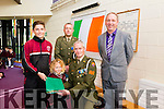 Defence Forces members Sergeant Chris Hoare, Killorglin originally and Gunner James Power, Waterford, presents the   tricolour and Proclamation to the youngest and Oldest pupils  Lauren Hurley and Conor Commane of Holy Family School Tralee to commemorate the 100 year anniversary here with Principal Ed O'Brian on Monday