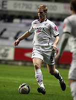 Pictured: Alan Tate of Swansea City in action<br />