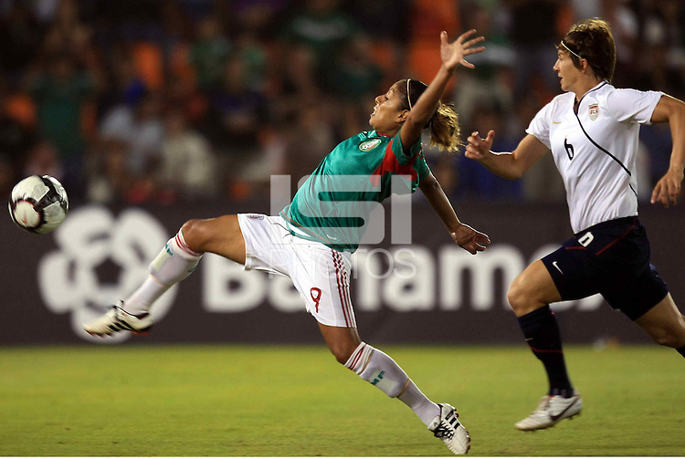 Maribel Dominguez of Mexico and Amy LePeilbet during the semifinal match of CONCACAF Women's World Cup Qualifying tournament held at Estadio Quintana Roo in Cancun, Mexico. Mexico 2, USA 1.