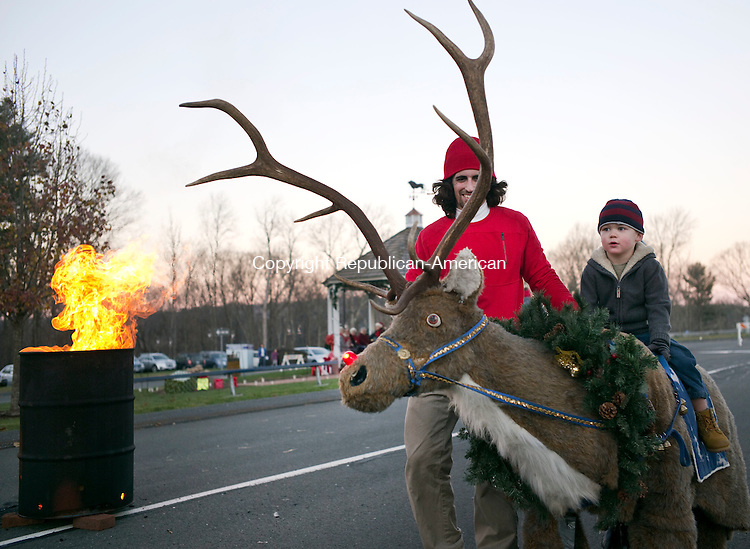 Harwinton, CT- 05 December 2015-120515CM05-   Blake Schibi 3 of Harwinton rides a reindeer, operated by Kyle Cromack with Safari Rides of Wallingford during the Harwinton Hometown Holiday Celebration on Saturday.      Christopher Massa Republican-American