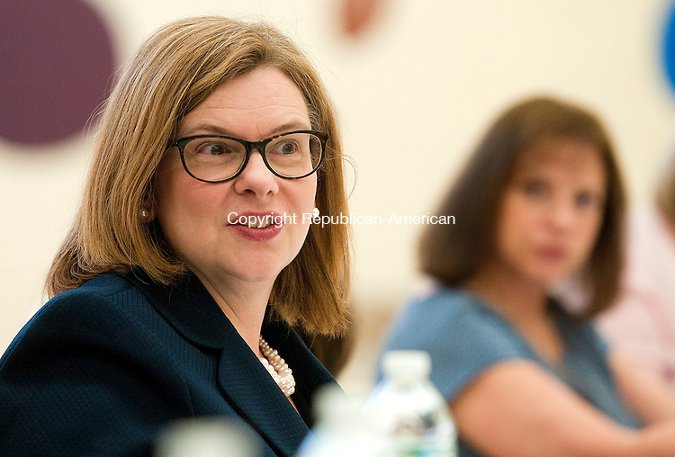 NAUGATUCK, CT--050715JS11-  Dr. Dianna R. Wentzell, Commissioner of the State Department of Education, talks with teachers, staff and local officials during a round table discussion while visiting the Andrew Avenue School in Naugatuck on Thursday. <br /> Jim Shannon Republican-American