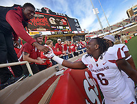 STAFF PHOTO BEN GOFF  @NWABenGoff -- 09/13/14 Arkansas defensive end JaMichael Winston greets fans after Arkansas defeated Texas Tech in Jones AT&T Stadium in Lubbock, Texas on Saturday September 13, 2014.