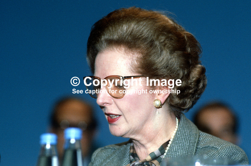 Margaret Thatcher, Prime Minister, UK, platform, annual conference, Conservative Party, Brighton, October, 1984, wearing glasses, following Provisional IRA bomb in the Grand Hotel, where the majority of Conservative Party VIPs were staying. 19840142MT2.<br /> <br /> Copyright Image from Victor Patterson, 54 Dorchester Park, Belfast, UK, BT9 6RJ<br /> <br /> t1: +44 28 9066 1296 (from Rep of Ireland 048 9066 1296)<br /> t2: +44 28 9002 2446 (from Rep of Ireland 048 9002 2446)<br /> m: +44 7802 353836<br /> <br /> victorpatterson@me.com<br /> www.victorpatterson.com<br /> <br /> Please see my Terms and Conditions of Use at victorpatterson.com . It is IMPORTANT that you familiarise yourself with them.<br /> <br /> Images used on the Internet incur an additional cost and must be visibly watermarked i.e. &copy;Victor Patterson within the body of the image and copyright metadata must not be deleted. Images used on the Internet have a size restriction of 4kbs and are chargeable at rates available at victorpatterson.com.<br /> <br /> This image is only available for the use of the download recipient i.e. television station, newspaper, magazine, book publisher, etc, and must not be passed on to any third party. It is also downloaded on condition that each and every usage is notified within 7 days to victorpatterson@me.com<br /> <br /> The right of Victor Patterson to be identified as the author is asserted in accordance with The Copyright Designs And Patents Act (1988). All moral rights are asserted.
