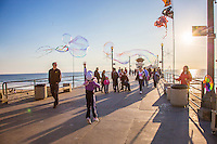 Young Girl Playing with Bubbles on the Huntington Beach Pier