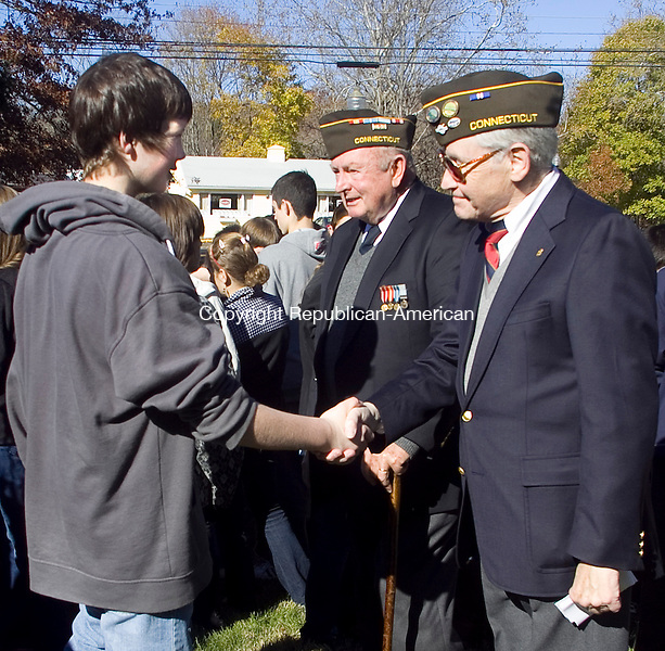 SOUTHBURY CT.-11 NOVEMBER 2010 111110DA05-  Conor Hurley an 8th-grade student of Rochambeau Middle School in Southbury shakes the hand and then says thank you to U.S. Navy Veteran Byron Gallup, right, and then U.S. Army Veteran Phil McGovern after a Veterans Day ceremony held at the Southbury Veterans Memorial Park on Thursday.<br /> Darlene Douty Republican American