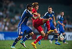 (L) Ever Banega of Argentina competes for the ball with (R) Yingzhi JU of Hong Kong during the HKFA Centennial Celebration Match between Hong Kong vs Argentina at the Hong Kong Stadium on 14th October 2014 in Hong Kong, China. Photo by Aitor Alcalde / Power Sport Images