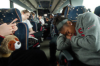 STANFORD, CA--Taylor Greenfield keeps busy on her mobile phone with pillow pet Callaway in tow while fellow freshman Jasmine Camp takes a rest on the bus ride to the airport en route to Norfolk, VA for the first and second rounds of the 2012 NCAA tournament.