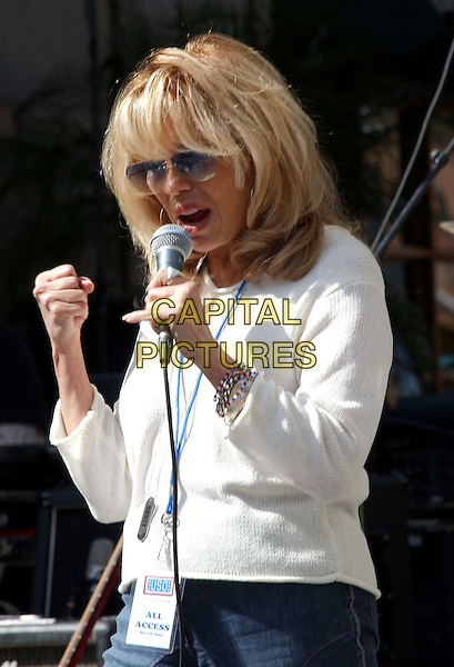 NANCY SINATRA .Perform For Service Members and Their Families At The USO's 'Salute to the Troops' Free Concert Held at Hollywood & Highland's Babylon Court.                             .singing, performing, music, stage, half length, half-length.www.capitalpictures.com.sales@capitalpictures.com.©Capital Pictures