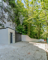 BNPS.co.uk (01202 558833)<br /> Pic: Strutt&Parker/BNPS<br /> <br /> The property is accessed from the foot of the cliffs...<br /> <br /> A former WW2 battery, with unrivalled views across the channel to France, has come on the market - but you'll need deep pockets to shell out on its stunning location.<br /> <br /> The cliff top gun emplacement was rapidly constructed in 1940, as Britsh troops were fleeing Dunkirk, and has now been transformed into a £6million 'James Bond style' property.<br /> <br /> The Gunnery, near Kingsdown in Kent offers 'incredible' views of the Channel, with the iconic White Cliffs of Dover visible to the west, and France to the south, while also coming with six acres of sandy beach.<br /> <br /> The unique 82ft long property is accessed by an underground tunnel that leads through the cliff to a glass lift which travels up to it. Another secret tunnel inside the four bedroom home, which is just a few feet from the cliff edge, provides passage to a home cinema.<br /> <br /> The 50ft long living room has floor to ceiling windows and the original gun loops can still be seen.