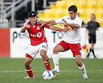 28 March 2007: Toronto's Alecko Eskandarian (10) and New York's Carlos Mendez (4) fight for the ball. Toronto FC defeated the New York Red Bulls 2-1 at Blackbaud Stadium in Cary, North Carolina in the 2007 Carolina Challenge Cup.