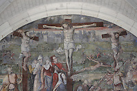 Crucifixion fresco, Chapter House, Fontevraud Abbey, Fontevraud-l'Abbaye, Loire Valley, Maine-et-Loire, France. The Chapter House was built in the 16th century and its walls were painted in 1563 with frescoes of scenes from Christ's Passion by the Anjou artist Thomas Pot. Here we see the Crucifixion with Christ on the cross and mourners. The abbey itself was founded in 1100 by Robert of Arbrissel, who created the Order of Fontevraud. It was a double monastery for monks and nuns, run by an abbess. Picture by Manuel Cohen