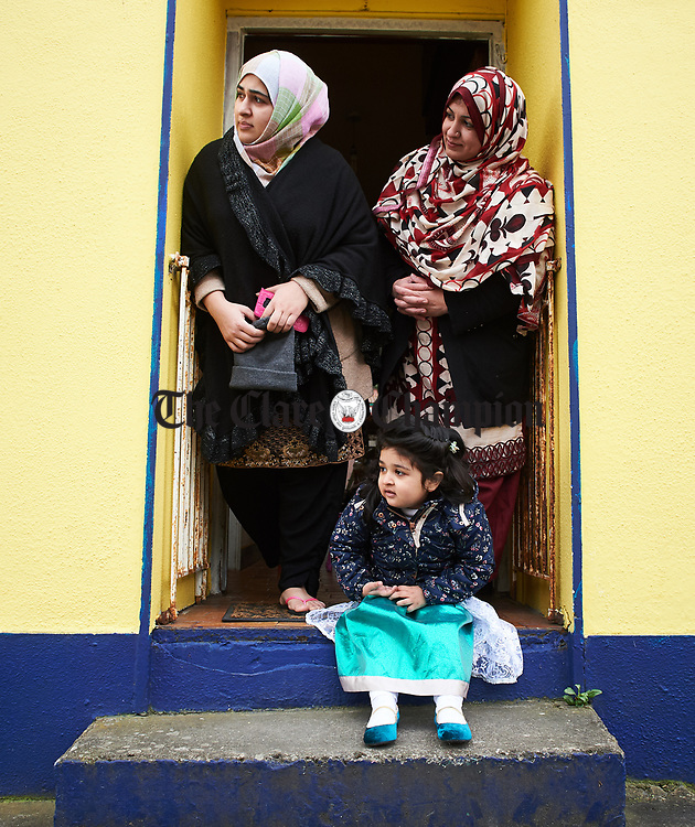 Nahal Fatima and her mother Iram and aunt Naila Naz watching the St Patrick's Day parade in Scariff. Photograph by John Kelly.