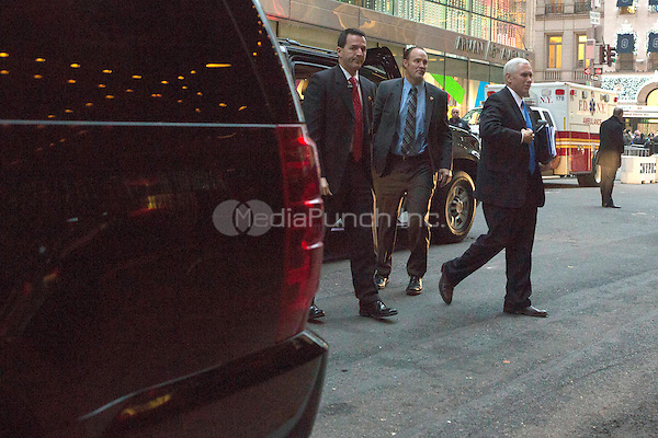 Mike Pence arrives at Trump Tower in Manhattan, New York, U.S., on Wednesday, December 7, 2016. POOL PHOTO BY John Taggart/BloombergUnited States Vice President-elect Mike Pence arrives at Trump Tower in Manhattan, New York, New York, USA on Wednesday, December 7, 2016. <br /> Credit: John Taggart / Pool via CNP /MediaPunch